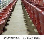 Small photo of Empty aisle between stadium seats.