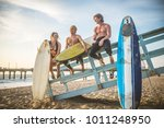 group of friends going to surf... | Shutterstock . vector #1011248950
