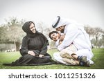 arabic family playing with child | Shutterstock . vector #1011251326