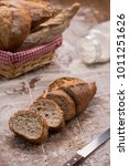baguette bread cut in slices... | Shutterstock . vector #1011251626