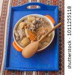 orange pot with stewed rabbit... | Shutterstock . vector #1011255118
