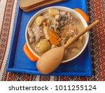 orange pot with stewed rabbit... | Shutterstock . vector #1011255124