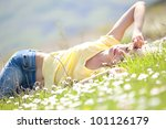 young woman lying on the grass | Shutterstock . vector #101126179