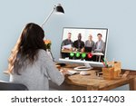 woman video conferencing with... | Shutterstock . vector #1011274003