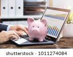 businessperson analyzing graph... | Shutterstock . vector #1011274084