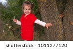 child with candy smiling next... | Shutterstock . vector #1011277120