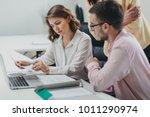 business team working on a... | Shutterstock . vector #1011290974