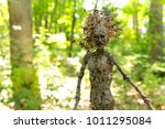 A Mythical Tree Woman Poses In...