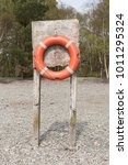 an old orange rustic life buoy... | Shutterstock . vector #1011295324