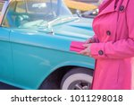 Woman In Hot Pink Coat Holding...