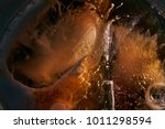 ice coffee pour texture | Shutterstock . vector #1011298594