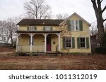 old abandoned farmhouse during... | Shutterstock . vector #1011312019