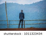 young in the mountains.the... | Shutterstock . vector #1011323434