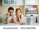 stressed couple in trouble ... | Shutterstock . vector #1011360286