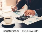 a businessman analyzing... | Shutterstock . vector #1011362884