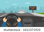Stock vector hands driving a car on the highway drive safely warning billboard flat vector illustration 1011371923