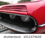 front of an old bright red... | Shutterstock . vector #1011374620