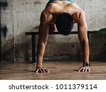 sport man with weight training... | Shutterstock . vector #1011379114