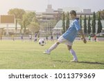 football in action during a... | Shutterstock . vector #1011379369