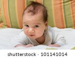 Adorable baby portrait looking at camera. - stock photo