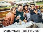 group of four friends having... | Shutterstock . vector #1011419230