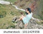 beautiful young woman sitting...   Shutterstock . vector #1011429358