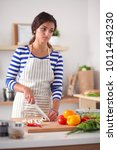 young woman in the kitchen... | Shutterstock . vector #1011443230