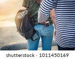 street thief stealing mobile... | Shutterstock . vector #1011450169