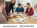 group of young businesspeople... | Shutterstock . vector #1011451969