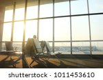 empty chairs and passenger in... | Shutterstock . vector #1011453610