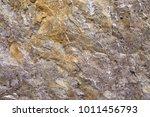 Granular limestone rock surface. Roe stone rock surface. Limestone crag texture. Roe-stone crag face. Limestone stone surface desktop pattern. Calcite crag idle screen. Calcspar reef desktop backdrop