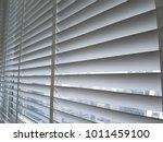 a venetian blind in white tone. ... | Shutterstock . vector #1011459100