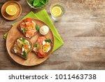 tasty bruschettas with olives... | Shutterstock . vector #1011463738