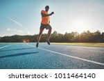 fit young african male athlete... | Shutterstock . vector #1011464140