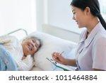 asian nurse checking up the... | Shutterstock . vector #1011464884