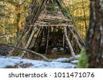 shelter made of branches in the ... | Shutterstock . vector #1011471076
