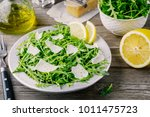 rocket salad with parmesan... | Shutterstock . vector #1011475723