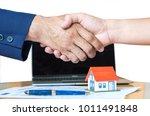 Home Salesman Shakes Hands Pen...