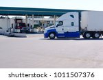 long haul big rig semi truck... | Shutterstock . vector #1011507376