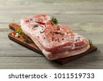raw bacon in whole on wooden... | Shutterstock . vector #1011519733
