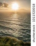 atlantic ocean at sunset in... | Shutterstock . vector #1011520018