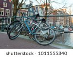 old bikes on a bridge in... | Shutterstock . vector #1011555340