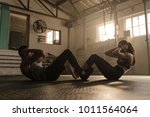 people working out in gym. fit... | Shutterstock . vector #1011564064
