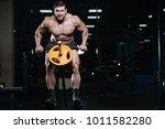 brutal sexy strong bodybuilder... | Shutterstock . vector #1011582280