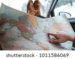 hipster traveler sitting in car ... | Shutterstock . vector #1011586069