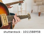 learning to play the guitar.... | Shutterstock . vector #1011588958
