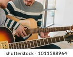 learning to play the guitar.... | Shutterstock . vector #1011588964