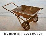An Old Rusty Wheelbarrow.