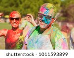 guy with a girl celebrate holi... | Shutterstock . vector #1011593899