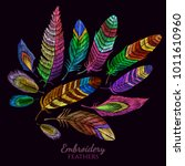 color feathers embroidery... | Shutterstock .eps vector #1011610960